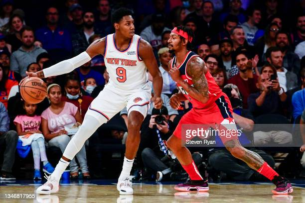 Barrett of the New York Knicks is defended by Bradley Beal of the Washington Wizards during a preseason game at Madison Square Garden on October 15,...