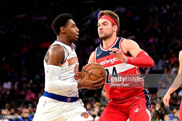 Barrett of the New York Knicks is defended by Corey Kispert of the Washington Wizards during a preseason game at Madison Square Garden on October 15,...