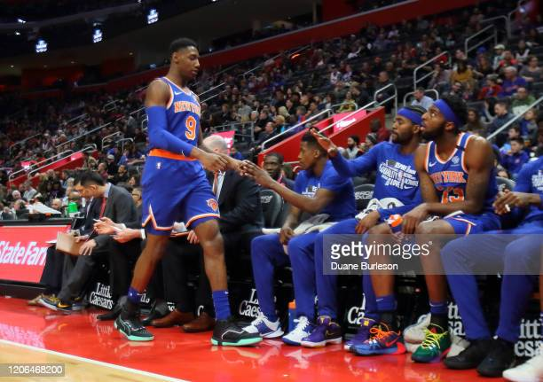 Barrett of the New York Knicks is greeted at the bench by teammates after leaving a game against the Detroit Pistons during the first half at Little...