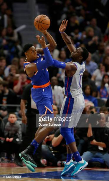 Barrett of the New York Knicks passes the ball against Reggie Jackson of the Detroit Pistons during the second half at Little Caesars Arena on...
