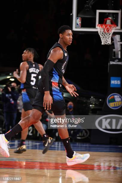 Barrett of the New York Knicks reacts to his three pointer during the game against the Memphis Grizzlies on April 9, 2021 at Madison Square Garden in...