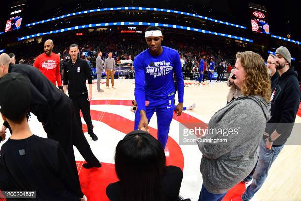 Barrett of the New York Knicks shakes a fans hand before the game against the Atlanta Hawks on February 09, 2020 at State Farm Arena in Atlanta,...