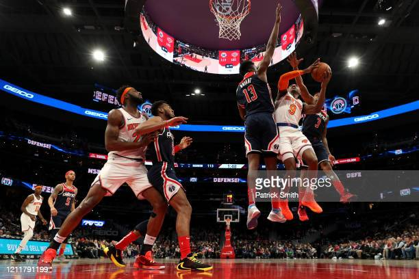Barrett of the New York Knicks shoots in front of Thomas Bryant and Bradley Beal of the Washington Wizards during the second half at Capital One...
