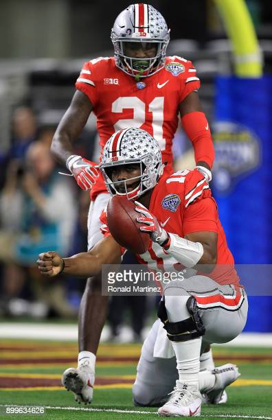 T Barrett of the Ohio State Buckeyes celebrates a 1yard touchdown run against the USC Trojans during the Goodyear Cotton Bowl at ATT Stadium on...
