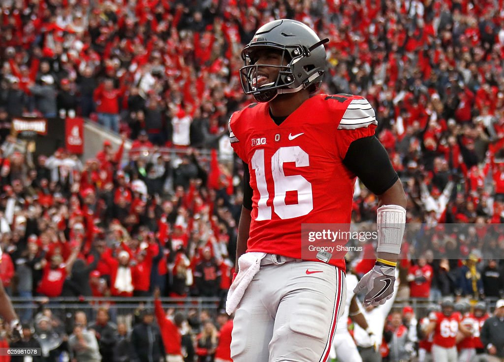 J.T. Barrett #16 of the Ohio State Buckeyes celebrates after rushing for a touchdown in overtime against the Michigan Wolverines at Ohio Stadium on November 26, 2016 in Columbus, Ohio.