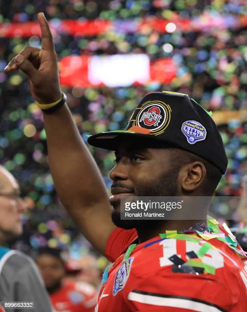 T Barrett of the Ohio State Buckeyes celebrates after winning the Goodyear Cotton Bowl against the USC Trojans at ATT Stadium on December 29 2017 in...