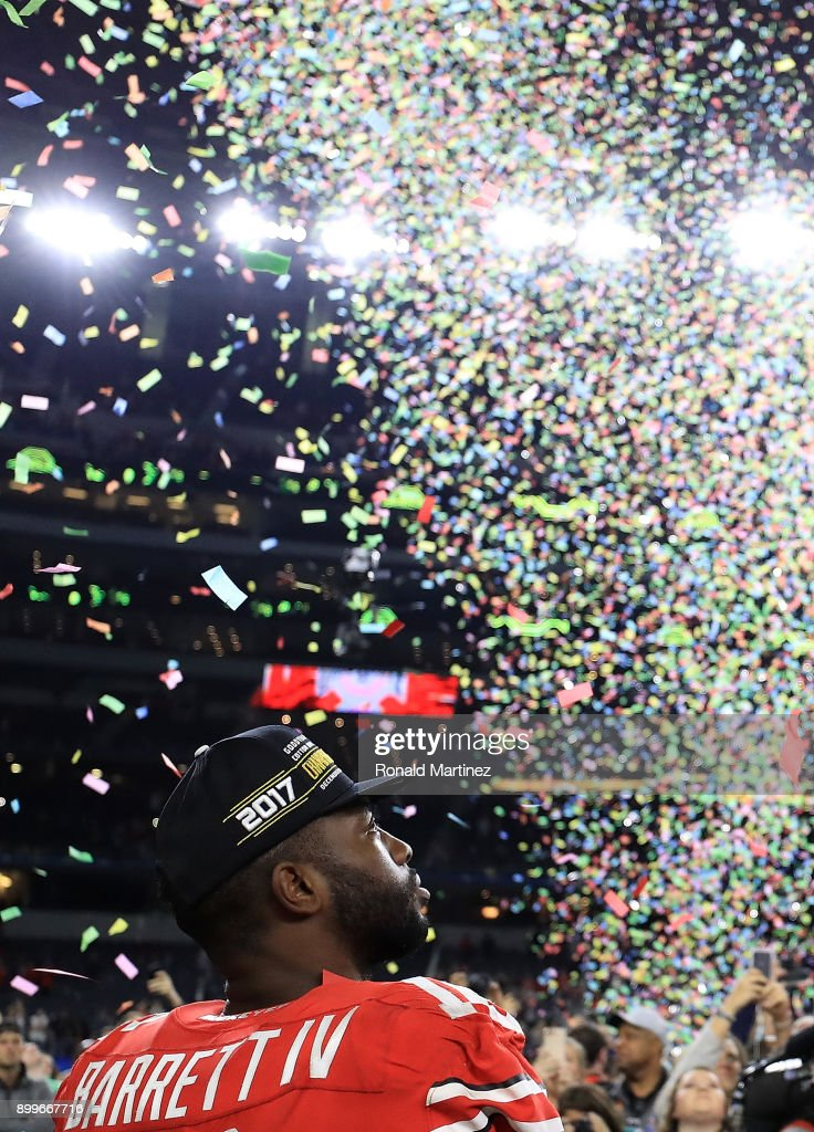 J.T. Barrett #16 of the Ohio State Buckeyes celebrates after winning the Goodyear Cotton Bowl against the USC Trojans at AT&T Stadium on December 29, 2017 in Arlington, Texas.