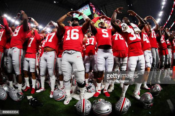 T Barrett of the Ohio State Buckeyes celebrates with his team after the Ohio State Buckeyes beat the USC Trojans 247 during the Goodyear Cotton Bowl...