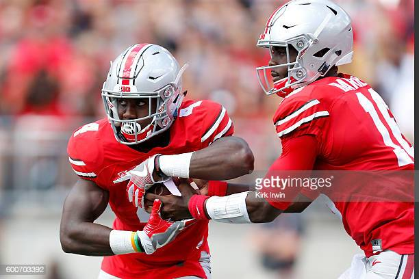 T Barrett of the Ohio State Buckeyes hands the ball off to Curtis Samuel of the Ohio State Buckeyes during the game against the Bowling Green Falcons...