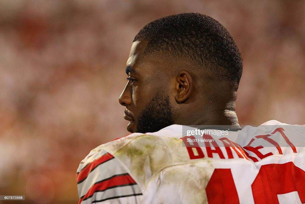 J.T. Barrett #16 of the Ohio State Buckeyes looks on against the Oklahoma Sooners at Gaylord Family Oklahoma Memorial Stadium on September 17, 2016 in Norman, Oklahoma.