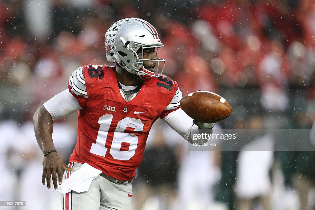 J.T. Barrett #16 of the Ohio State Buckeyes looks to hand the ball off in the second quarter against the Michigan State Spartans at Ohio Stadium on November 21, 2015 in Columbus, Ohio.