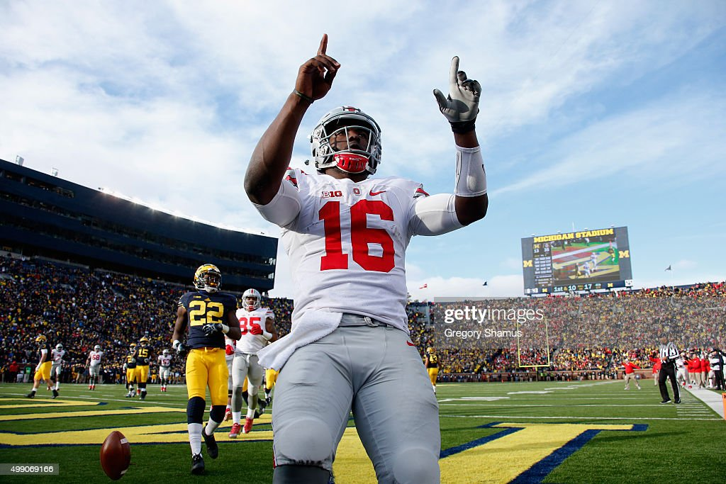 J.T. Barrett #16 of the Ohio State Buckeyes of the Ohio State Buckeyes celebrates after rushing for a fourth quarter touchdown against the Michigan Wolverines at Michigan Stadium on November 28, 2015 in Ann Arbor, Michigan.