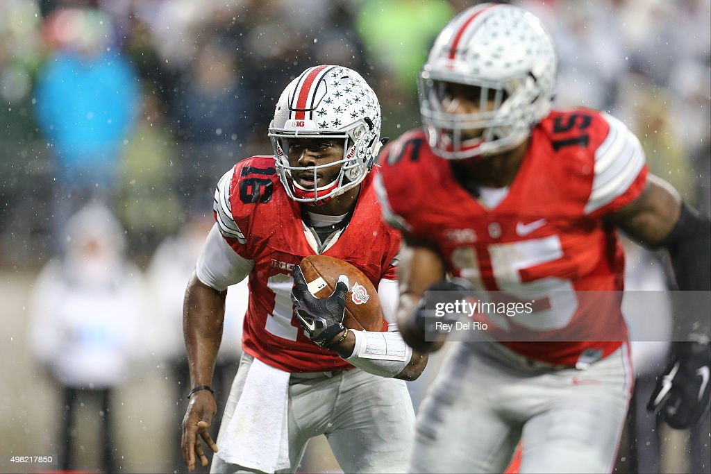 J.T. Barrett #16 of the Ohio State Buckeyes runs the ball the second quarter against the Michigan State Spartans at Ohio Stadium on November 21, 2015 in Columbus, Ohio.