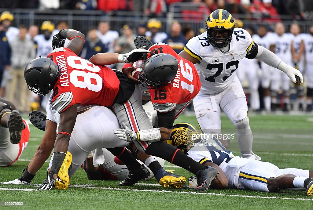 J.T. Barrett #16 of the Ohio State Buckeyes rushes for a first down during overtime of the game against the Michigan Wolverines at Ohio Stadium on November 26, 2016 in Columbus, Ohio.