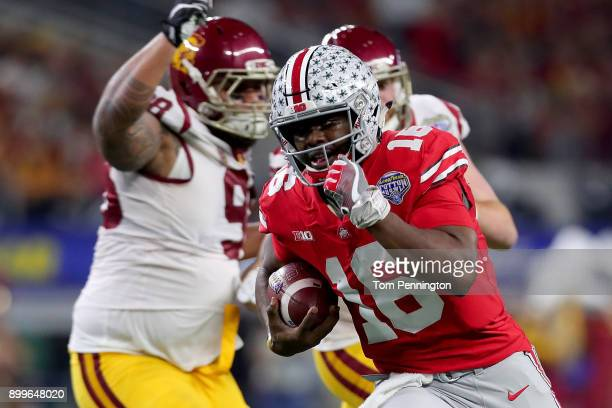 T Barrett of the Ohio State Buckeyes scores a touchdown against Josh Fatu of the USC Trojans and Cameron Smith of the USC Trojans in the first half...