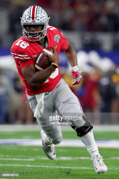 T Barrett of the Ohio State Buckeyes scores a touchdown against the USC Trojans in the first half during the Goodyear Cotton Bowl Classic at ATT...