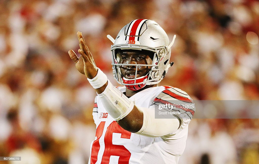 J.T. Barrett #16 of the Ohio State Buckeyes waits for a play on the field in the first half of their game against the Oklahoma Sooners at Gaylord Family Oklahoma Memorial Stadium on September 17, 2016 in Norman, Oklahoma.