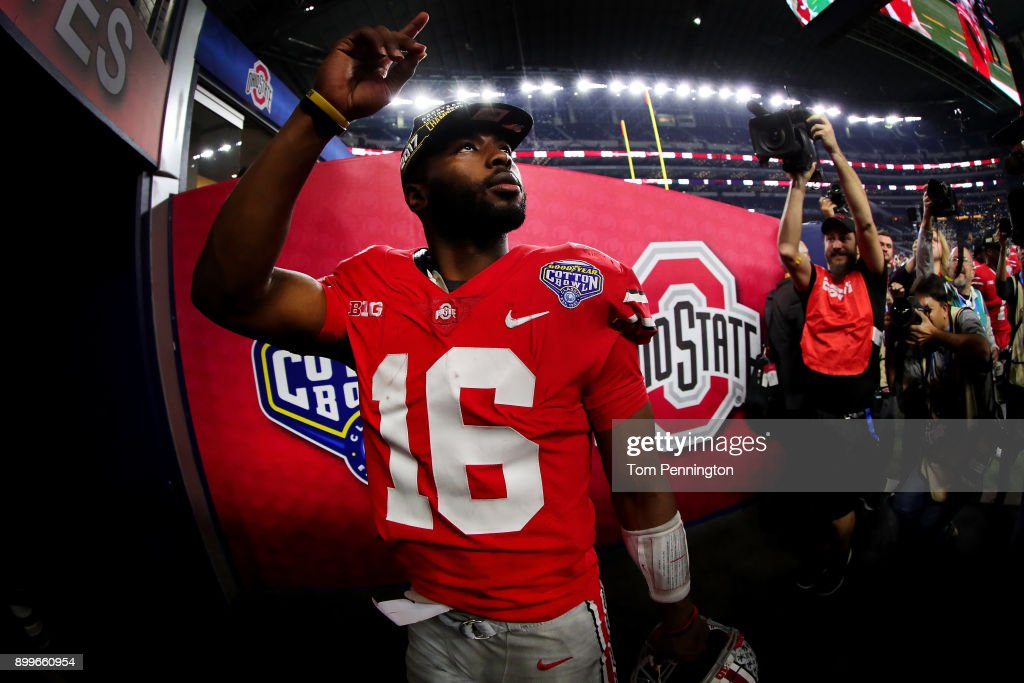 J.T. Barrett #16 of the Ohio State Buckeyes walks off the field after the Ohio State Buckeyes beat the USC Trojans 24-7 during the Goodyear Cotton Bowl Classic at AT&T Stadium on December 29, 2017 in Arlington, Texas.
