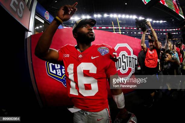 T Barrett of the Ohio State Buckeyes walks off the field after the Ohio State Buckeyes beat the USC Trojans 247 during the Goodyear Cotton Bowl...