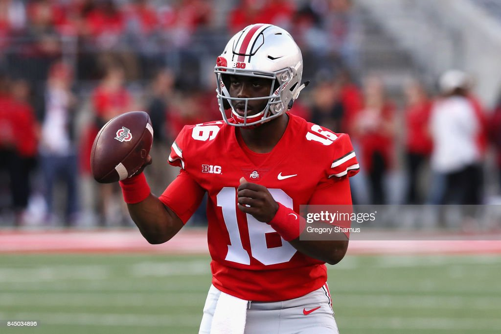 J.T. Barrett #16 of the Ohio State Buckeyes warms up before the game against the Oklahoma Sooners at Ohio Stadium on September 9, 2017 in Columbus, Ohio.