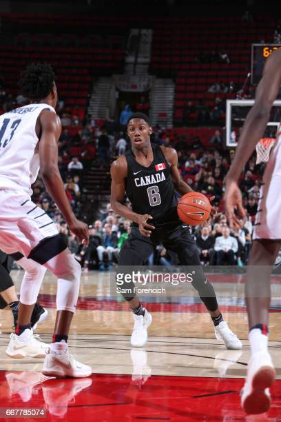 J Barrett of the World Select Team drives against the USA Junior Select Team during the game on April 7 2017 at the MODA Center Arena in Portland...