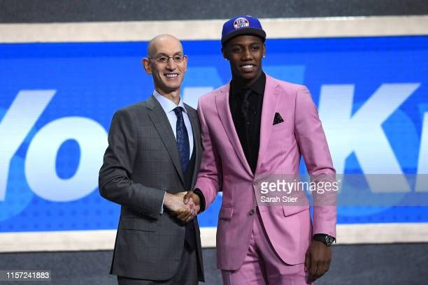 Barrett poses with NBA Commissioner Adam Silver after being drafted with the third overall pick by the New York Knicks during the 2019 NBA Draft at...