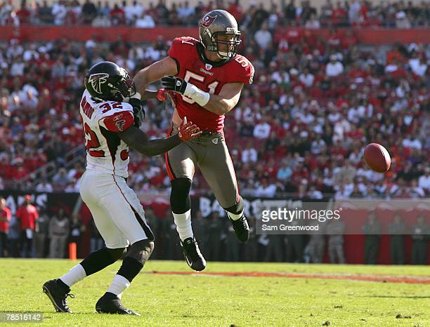 Barrett Ruud of the Tampa Bay Buccaneers breaks up a pass to Jerious Norwood of the Atlanta Falcons at Raymond James Stadium on December16 2007 in...