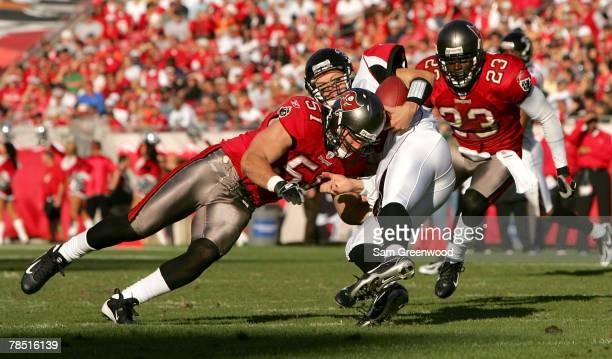 Barrett Ruud of the Tampa Bay Buccaneers makes a tackle against Chris Redman of the Atlanta Falcons at Raymond James Stadium on December16 2007 in...