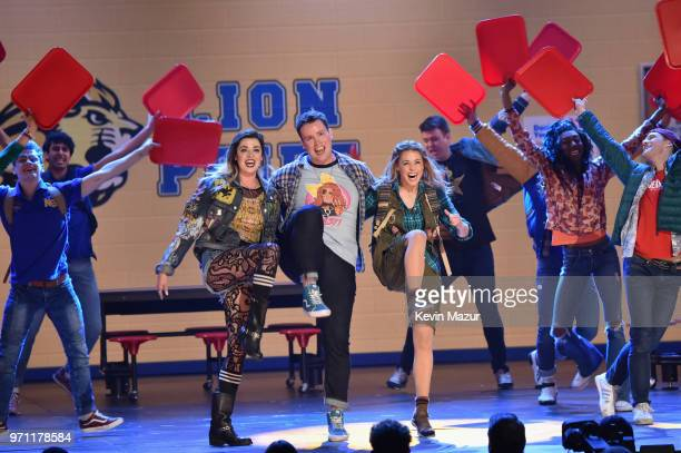 Barrett Wilbert Weed Grey Henson Erika Henningsen and the cast of Mean Girls perform onstage during the 72nd Annual Tony Awards at Radio City Music...