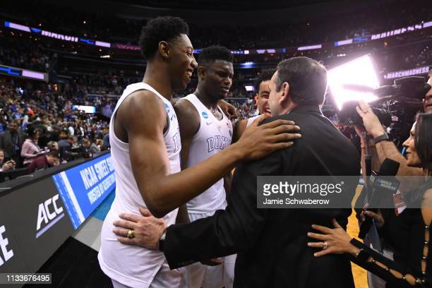Barrett Zion Williamson and Tre Jones embrace Head Coach Mike Krzyzewski of the Duke Blue Devils after defeating Virginia Tech Hokies in the third...