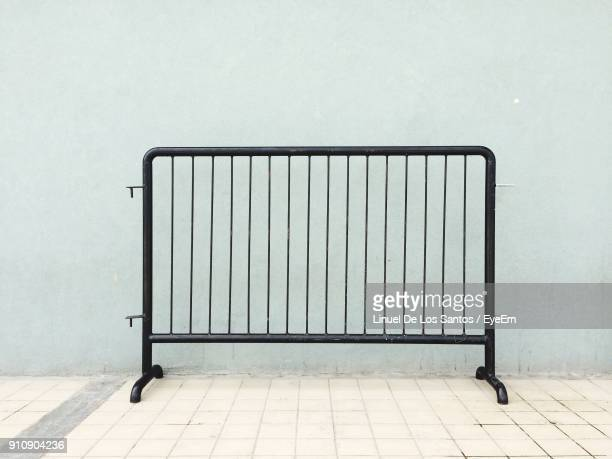 Barricade Against Wall On Footpath