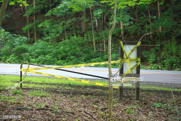 barricade and caution tape on playground and fitness equipment warning of covid-19 pandemic closure - governor stock pictures, royalty-free photos & images