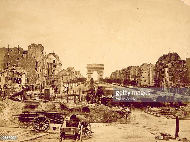 A barricade at the Porte Maillot during the revolt by supporters of the Paris Commune The Arc de Triomphe is in the background