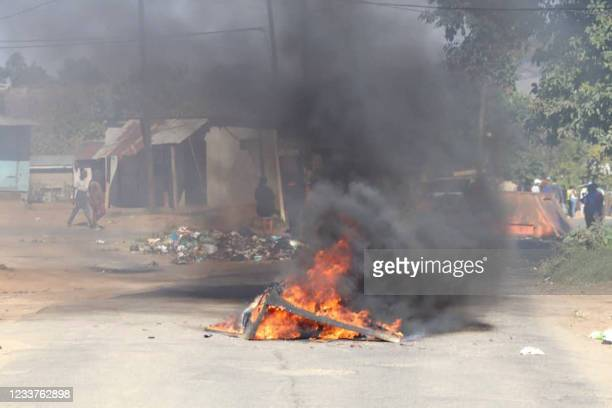 Barricade in the road that is on fire is seen in Mbabane, Eswatini, on June 29, 2021. - Demonstrations escalated radically in Eswatini this week as...
