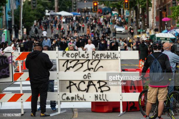 A barricade is seen at an entrance to the socalled Capitol Hill Autonomous Zone on June 10 2020 in Seattle Washington The zone includes the blocks...