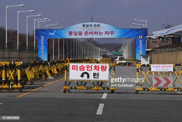 A barricade is set on the road leading to the truce village of Panmunjom at a South Korean military checkpoint in the border city of Paju near the...