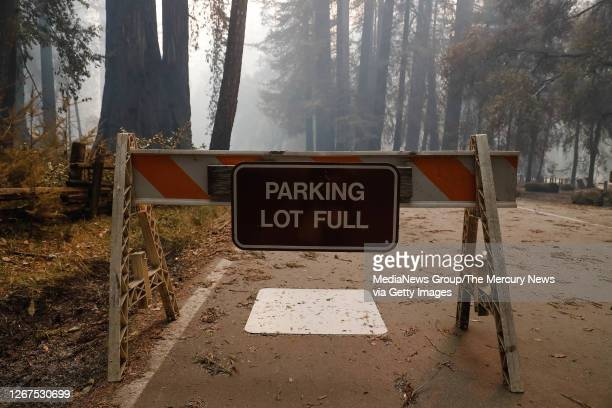 Barricade notifying visitors that the parking lot is full sits outside of Big Basin Redwoods State Park Headquarters & Visitor Center in Boulder...