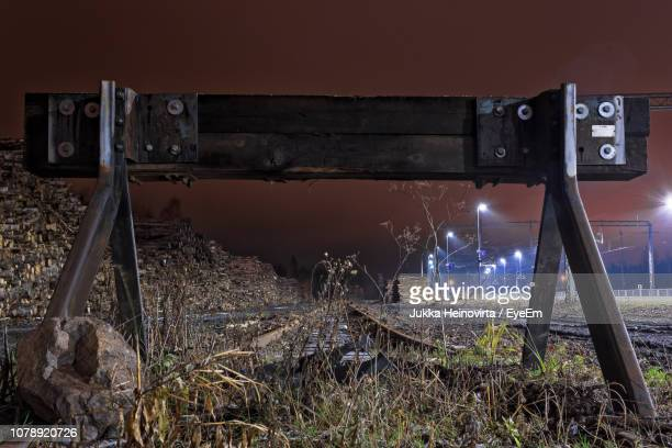 barricade on railroad track at night - heinovirta stock photos and pictures