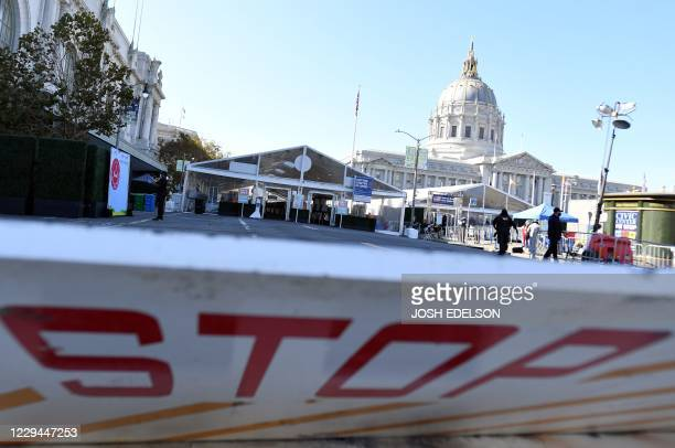 A barricade placed to stop vehicle traffic marks the entrance to a polling station where voters cast their ballots at Civic Center in San Francisco...