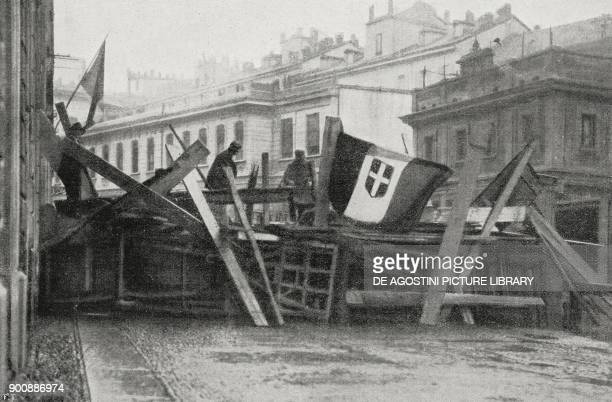Barricade to defend the National Fascist Party headquarters in via San Marco in Milan March on Rome Italy from L'Illustrazione Italiana Year XLIX No...