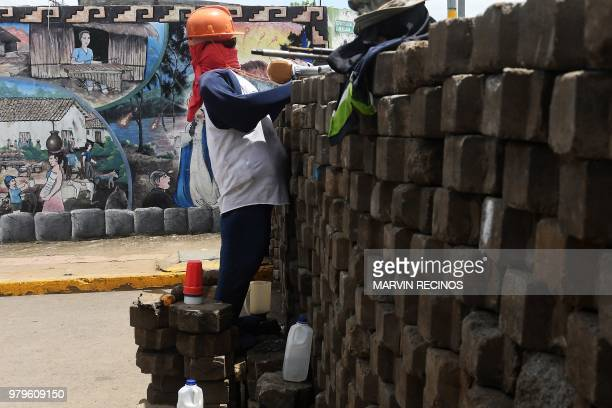 A barricade with a mannequin dressed up as a protester is seen in a street of Masaya Nicaragua on June 20 2018 The rebel city of Masaya continues the...