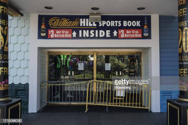 Barricades and caution tape block the entrance to a William Hill sports book casino in Las Vegas, Nevada, U.S., on Wednesday, April 15, 2020....