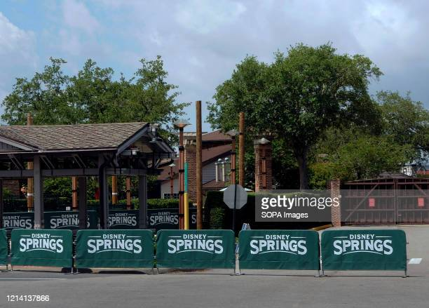 Barricades and closed gates are seen at the entrance to Disney Springs at Walt Disney World a day before the retail dining and entertainment complex...