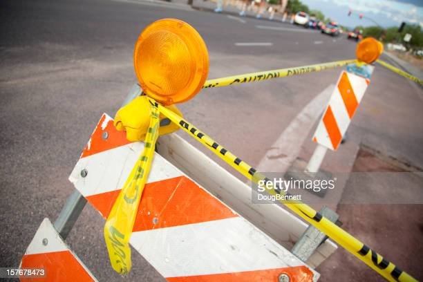 Barricades and Yellow Caution Tape for Road Construction