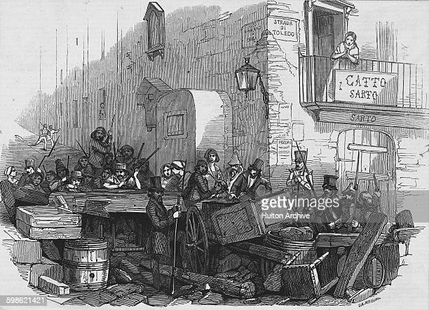 Barricades are manned by revolutionaries on the Strada di Toledo in Naples during the Sicilian revolution of independence on 15 May 1848 at Naples...
