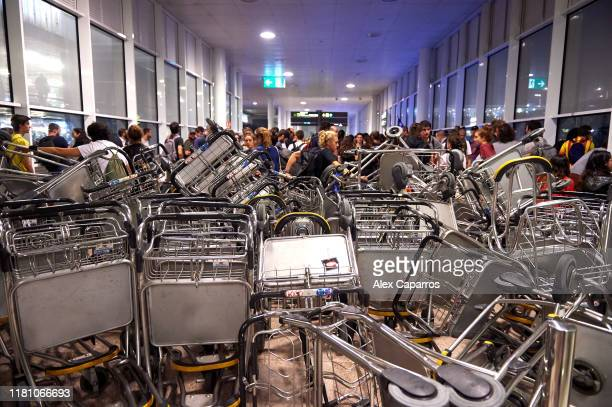 Barricades are seen at Barcelona Airport as people take part in a protest following the sentencing of nine Catalan separatist leaders on October 14...