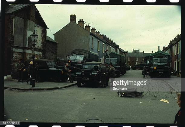 Barricades inside the Falls Road area are manned by British troops several of whom are shown eating and relaxing in some side streets of the Falls...