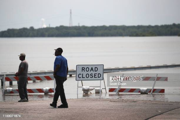 Barricades keep traffic from travelling down a road covered with floodwater from the Mississippi River on June 1 2019 in West Alton Illinois The...