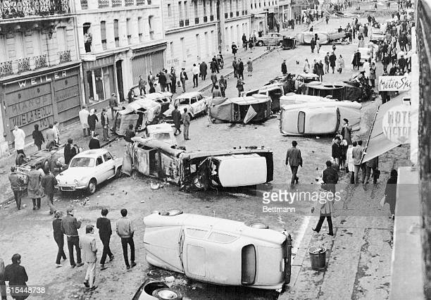 Barricades made of overturned cars block Gay Lussac Street in Paris after rioting and demonstrations by students demanding sweeping reforms at the...