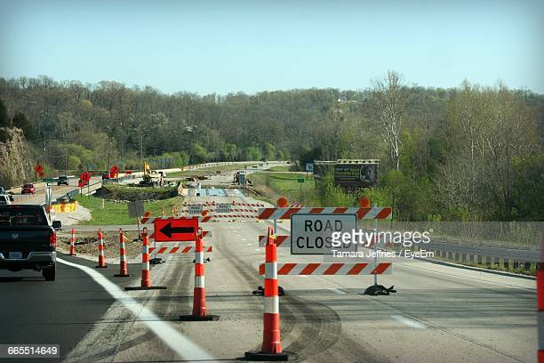 barricades on road amidst trees against clear sky - barricade stock pictures, royalty-free photos & images